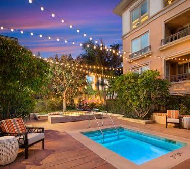 Exterior view of pool at Malibu - Villas Playa Vista Apartment Homes in Los Angeles, CA.