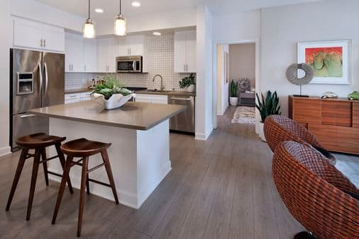Interior view of living area and kitchen at Malibu - Villas Playa Vista Apartment Homes in Los Angeles, CA.