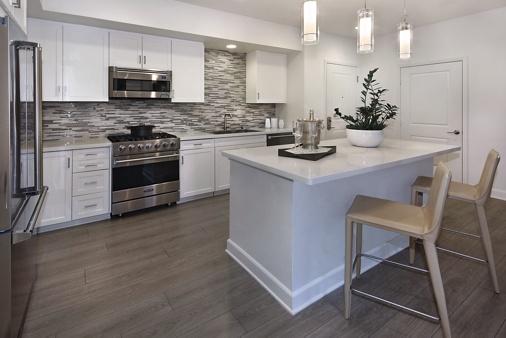 Interior view of kitchen at Montecito - Villas at Playa Vista Apartment Homes in Los Angeles, CA.