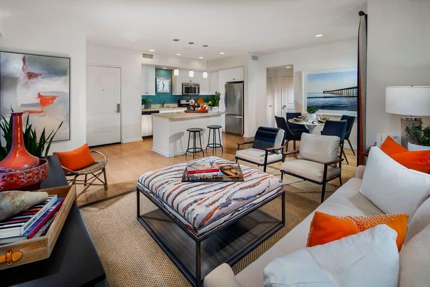 Interior view of kitchen and living room at Sausalito - Villas at Playa Vista Apartment Homes in Los Angeles, CA.