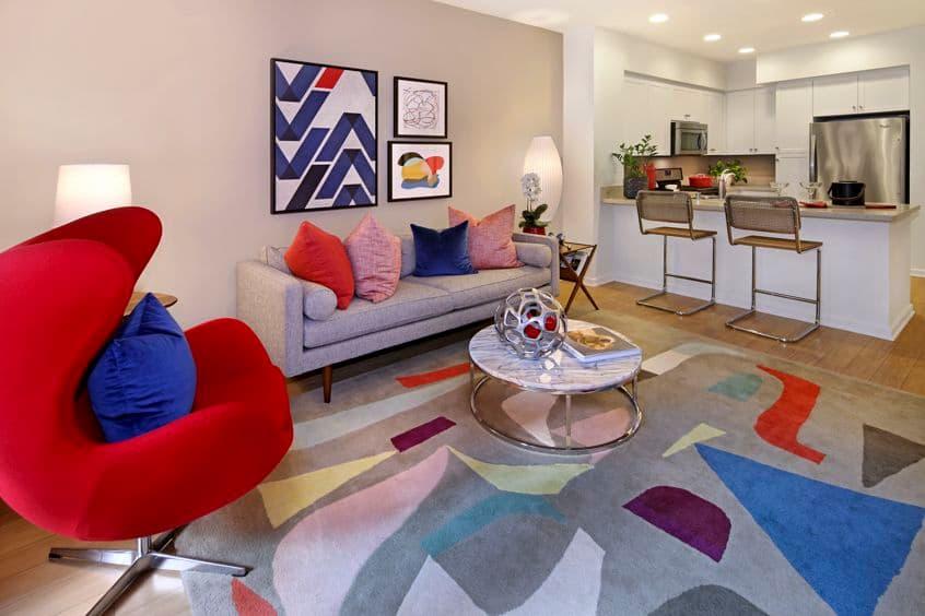 Interior view of living room and kitchen in Plan 25 at Sausalito - Villas at Playa Vista Apartment Homes in Los Angeles, CA.