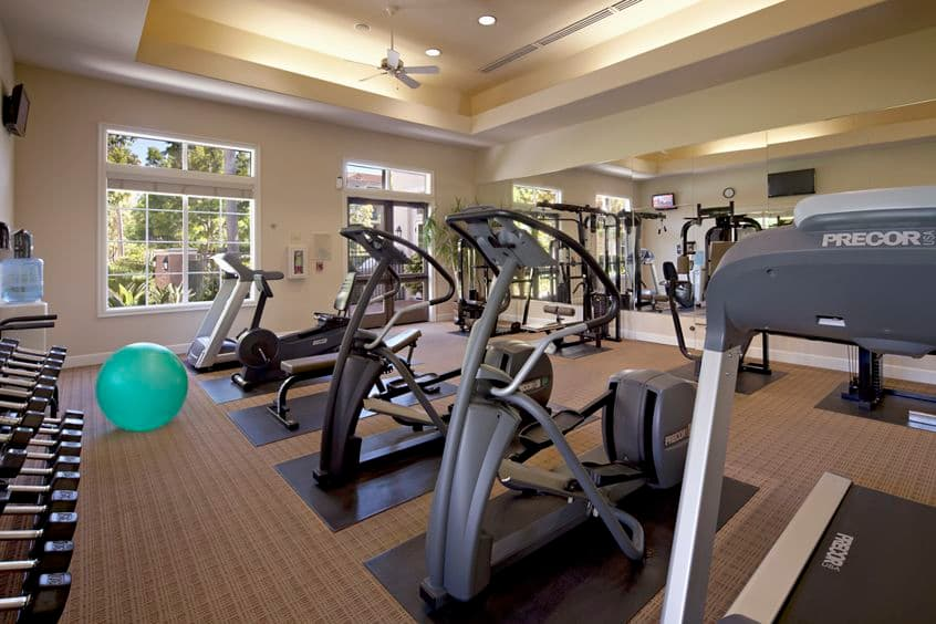Interior view of fitness center at Cherry Orchard Apartment Homes in Sunnyvale, CA.