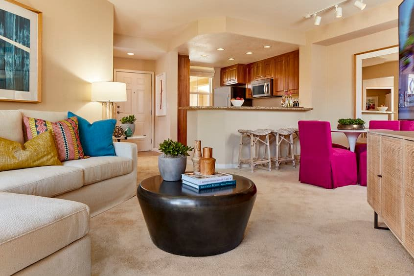 Interior view of kitchen, living room and dining room at Cherry Orchard Apartment Homes in Sunnyvale, CA.