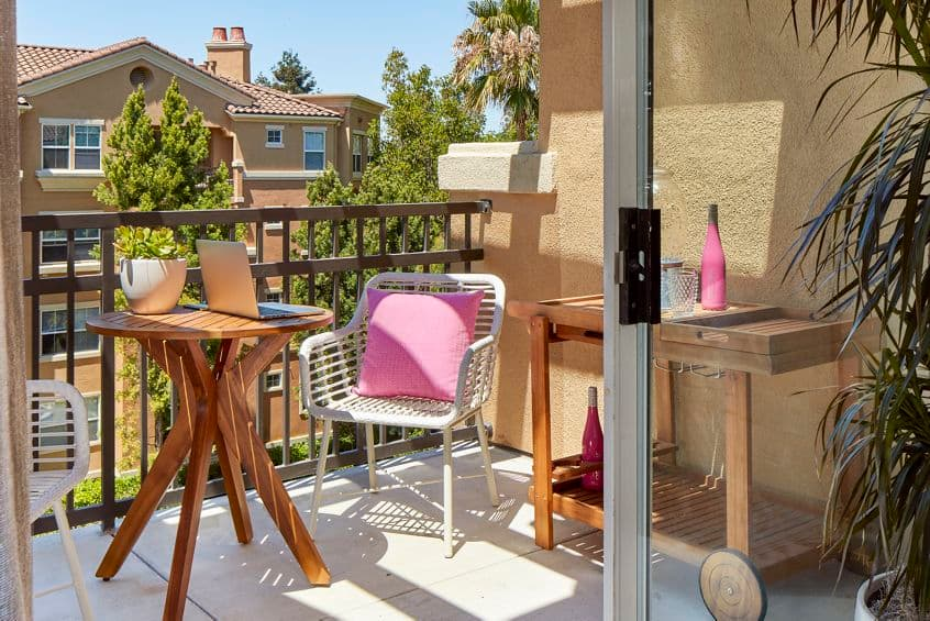 Exterior view of patio balcony of apartment at Cherry Orchard Apartment Homes in Sunnyvale, CA.