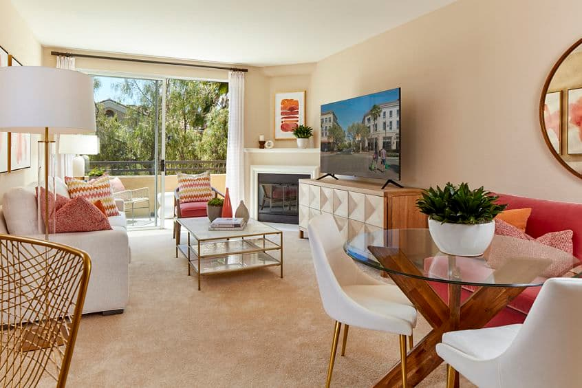 Interior view of living room and dining room at Cherry Orchard Apartment Homes in Sunnyvale, CA.