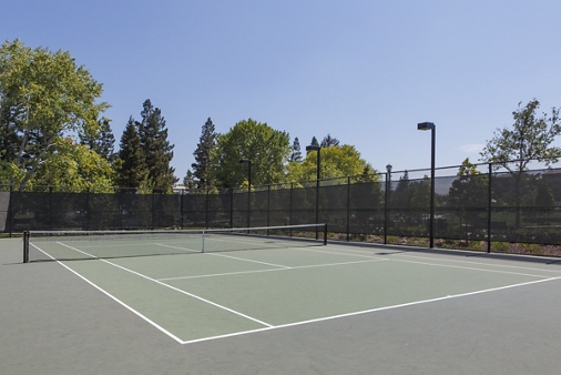 Detail view of a tennis court at River Oaks Park at Crescent Village Apartment Homes in San Jose, CA.