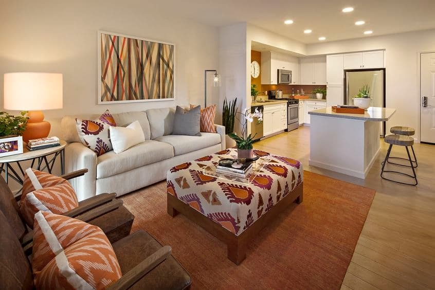 Interior view of a living room and kitchen at Verona at Crescent Village Apartment Homes in San Jose, CA.