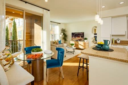 Interior view of Kitchen, Dining Room and Living Room at Crescent Village Apartment Homes in San Jose, CA.