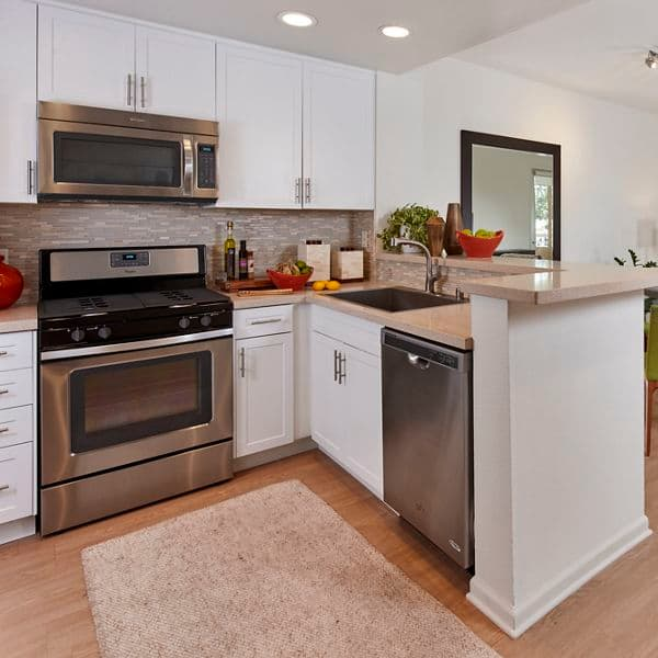 Interior view of kitchen at Franklin Street Apartment Homes in Redwood City, CA.