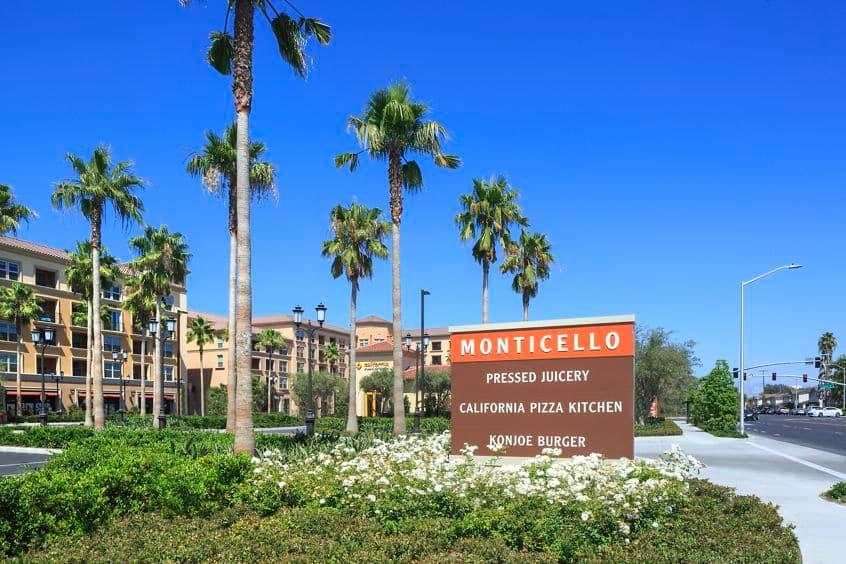 Exterior view of monument sign at Monticello Apartment Homes in Santa Clara, CA.