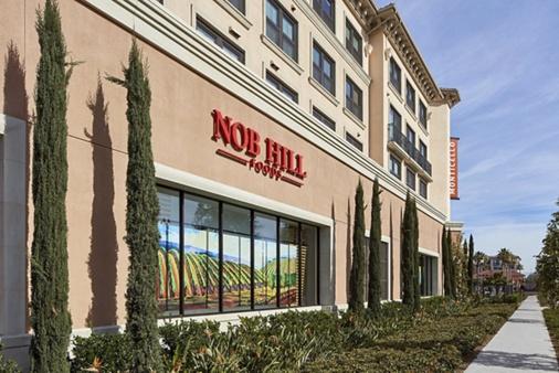 Exterior view of Nob Hill foods at Monticello Apartment Homes in Santa Clara, CA.
