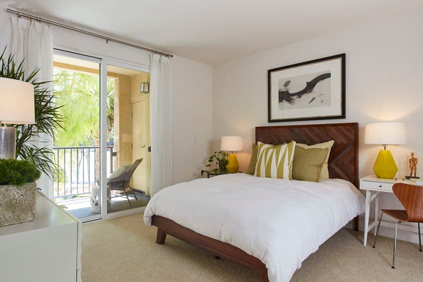 Interior view of bedroom at The Oaks at North Park Apartment Homes in San Jose, CA.