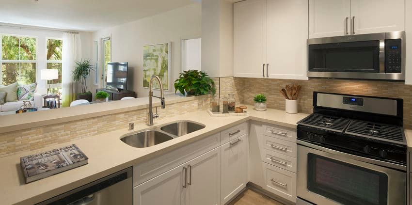 Interior view of the kitchen at The Oaks at North Park Apartment Homes in San Jose, CA.