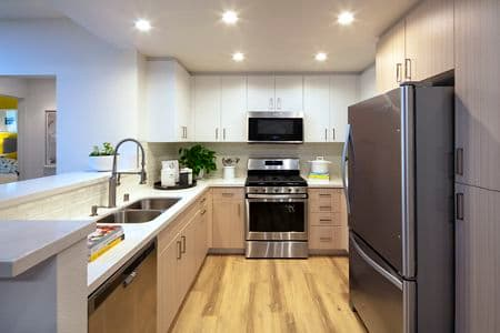 Interior view of a kitchen at The Pines at North Park Apartment Homes in San Jose, CA.