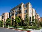 View of building exterior at The Redwoods at North Park Apartment Homes in San Jose, CA.