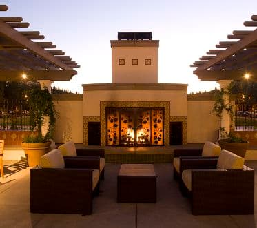 Exterior view of a fireplace at The Sycamores at North Park Apartment Homes in San Jose, CA.