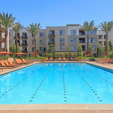 Exterior view of pool at River View Apartment Homes in San Jose, CA.