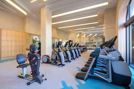 Interior view of the Fitness Center at Santa Clara Square Apartment Homes in Santa Clara, CA.