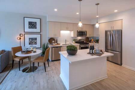 Interior view of Kitchen and Dining Room at Santa Clara Square Apartment Homes in Santa Clara, CA.