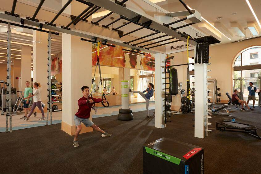Interior view of fitness center at Santa Clara Square Apartment Homes in Santa Clara, CA.
