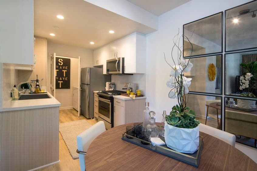 Interior view of the kitchen and dining area at The Hamptons Apartment Homes in Cupertino, CA.