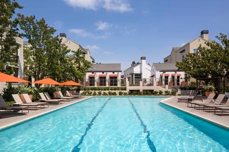 Exterior view of a pool at The Hamptons Apartment Homes in Cupertino, CA.