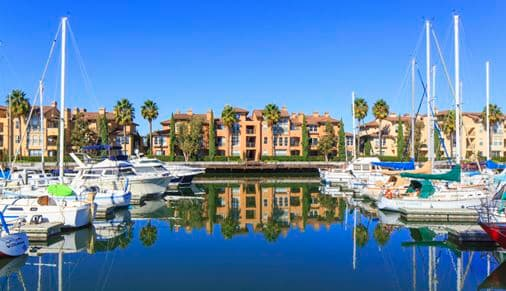 View of building exterior and waterfront bay views at The Villas at Bair Island Apartment Homes in Redwood City, CA.