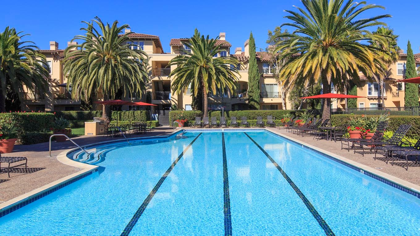 Exterior view of a pool at The Villas at Bair Island Apartment Homes in Redwood City, CA.
