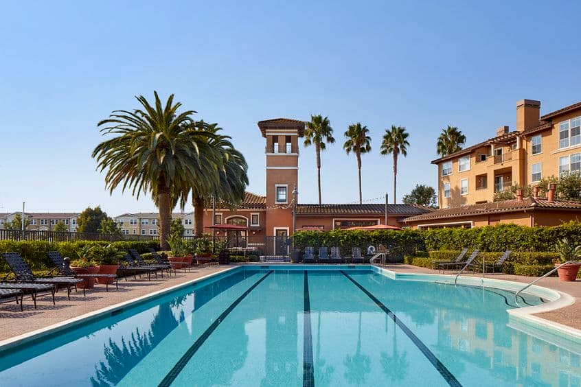 Exterior view of pool at The Villas at Bair Island Apartment Homes in Redwood City, CA.