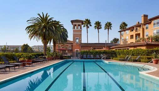 Exterior view of pool at The Villas at Bair Island Apartment Homes in Redwood City, CA.