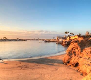 Sunset over the harbor in Corona del Mar, California at the beach in the United States