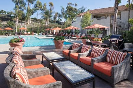 Exterior view of pool at Aliso Town Center Apartment Homes in Aliso Viejo, CA.