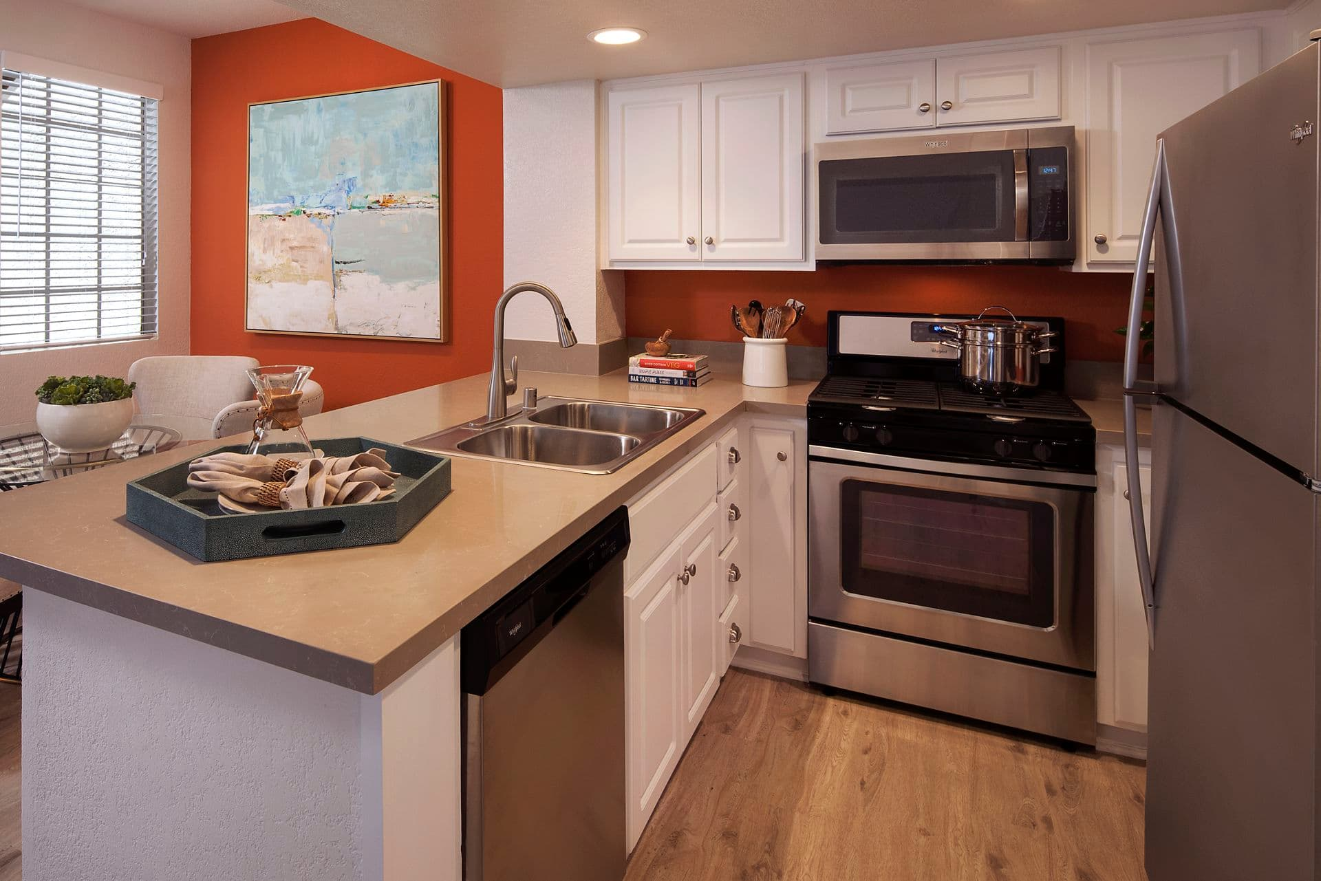Interior view of kitchen at Aliso Town Center Apartment Homes in Aliso Viejo, CA.