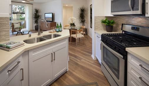 Interior view of a kitchen at Vista Bella Apartment Homes in Aliso Viejo, CA.