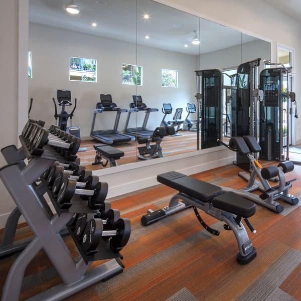 Interior view of the fitness center at Vista Bella Apartment Homes in Aliso Viejo, CA.