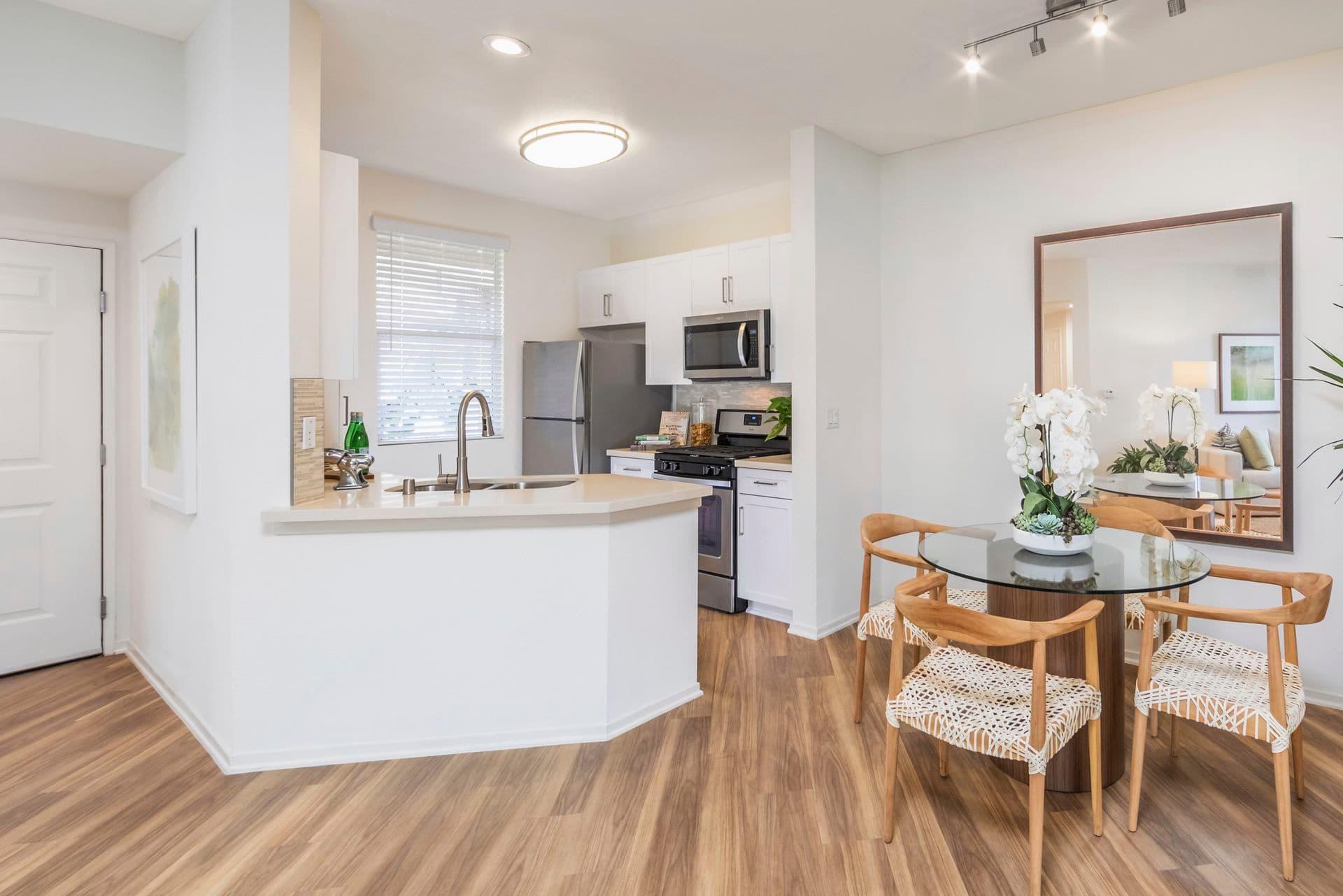Interior view of dining room  at Vista Bella Apartment Homes in Aliso Viejo, CA.