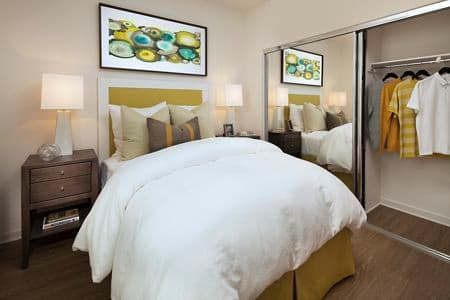 Interior view of bedroom at The Enclave Apartment Homes in Costa Mesa, CA.