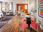 Interior view of living room, dining room and kitchen at The Enclave Apartment Homes in Costa Mesa, CA.