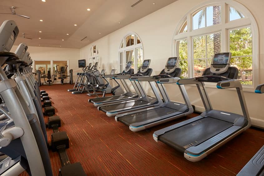 Interior view of fitness center at The Enclave at South Coast Apartment Homes in Costa Mesa, CA.
