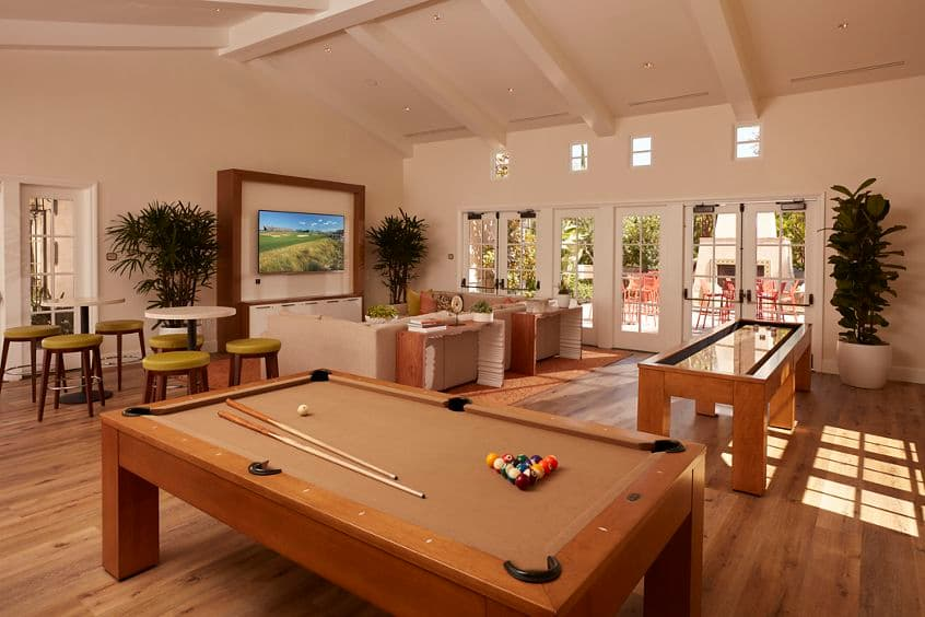 Interior view of Game Center at The Enclave at South Coast Apartment Homes in Costa Mesa, CA.