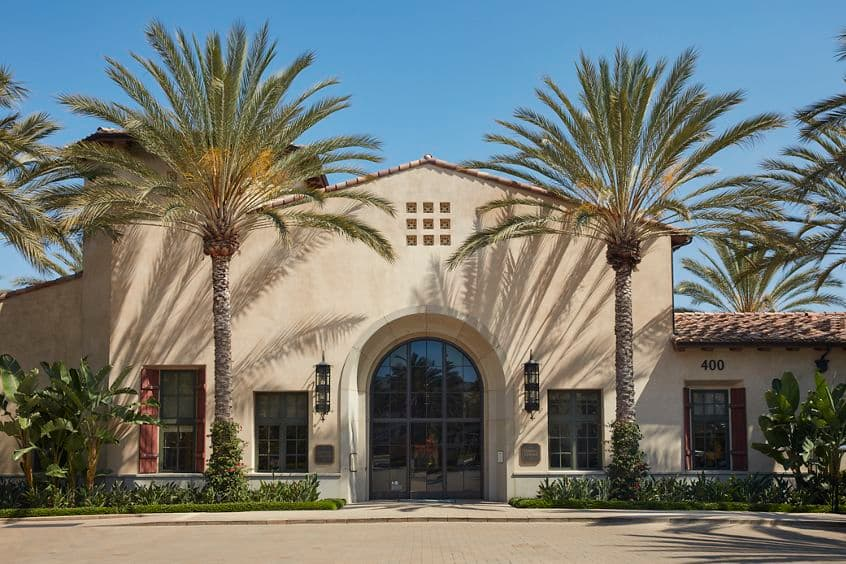 Exterior view of Leasing Center at The Enclave at South Coast Apartment Homes in Costa Mesa, CA.