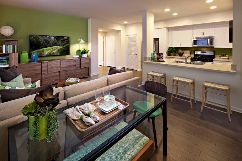 Interior view of living area and kitchen at Avella Apartment Homes in Irvine, CA.