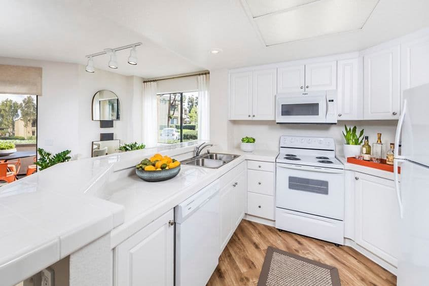 Interior view of kitchen at Cedar Creek Apartment Homes in Irvine, CA.
