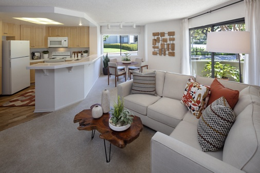 Interior view of living room, dining room and kitchen at Cross Creek Apartment Homes in Irvine, CA.