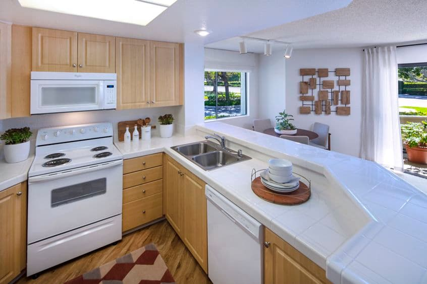 Interior view of kitchen at Cross Creek Apartment Homes in Irvine, CA.