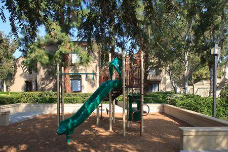 Exterior view of children's playground at Cross Creek Apartment Homes in Irvine, CA.