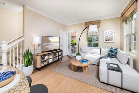 Interior view of living room at Cadenza at Cypress Village Apartment Homes in Irvine, CA.
