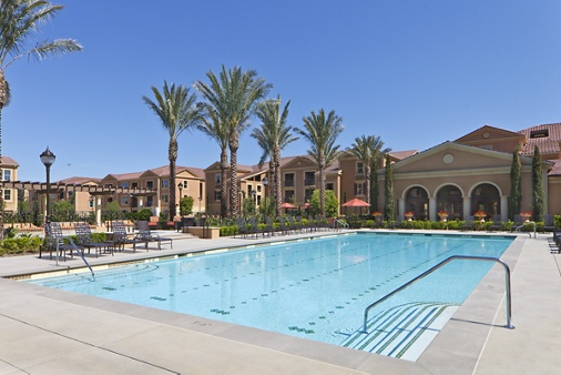 Exterior view of pool at Murano Apartment Homes at Cypress Village in Irvine, CA.