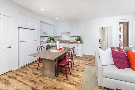 Interior view of dining and kitchen at Murano Apartment Homes at Cypress Village in Irvine, CA.