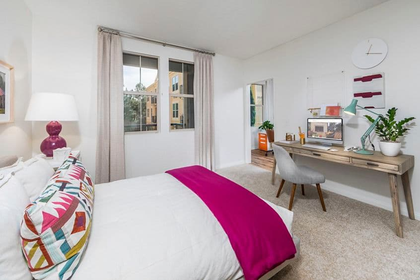 Interior view of bedroom Murano Apartment Homes at Cypress Village in Irvine, CA.